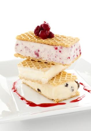 Delicious triple decker wafer ice cream with raspberry, vanilla and coffee and raisin ice cream. Stock Photo