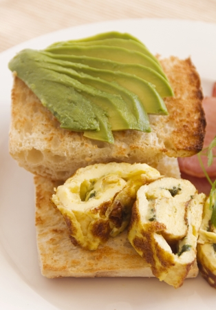 turkish bread: Sliced avocado on toasty Turkish bread with rolled omelette ready to serve.