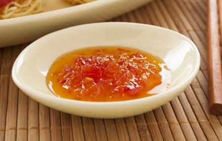 chilli sauce: Sweet chilli sauce in a bowl ready to serve.