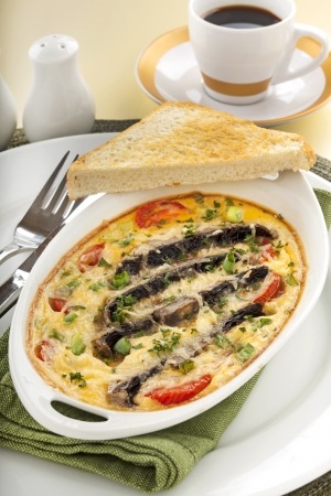 Delicious mushroom and tomato bake served with toast for breakfast. photo