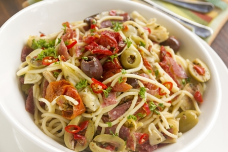 Delicious Mediterranean salami spaghetti with assorted vegetables ready to serve. photo
