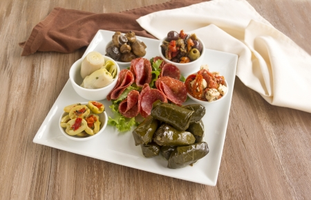 Delicious freshly prepared mezze platter cosisting of a variety of mediterranean foods. photo