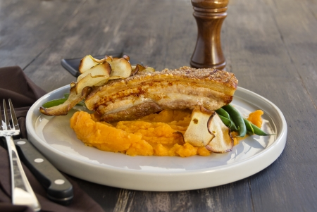 crackling: Delicious roasted pork belly with crackling, sweet potato mash, fried apple crisps and steamed green beans.