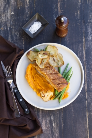 belly pepper: Delicious roasted pork belly with crackling, sweet potato mash, fried apple crisps and steamed green beans.
