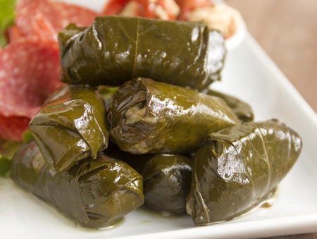 antipasto platter: Greek dolmades wrapped with vine leaves feature in a mezze platter  Stock Photo