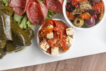 antipasto platter: Feta cheese and sundried tomato on an antipasto platter.