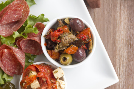 antipasto platter: Delicious black olives and stuffed green olives with sundried tomato on a antipasto platter. Stock Photo