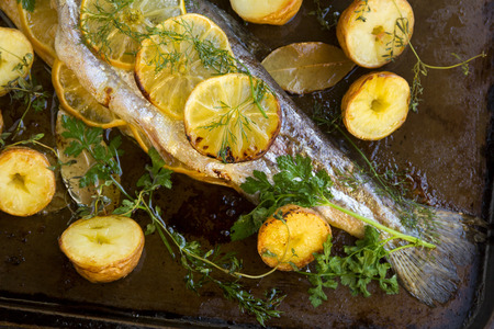 stuffed fish: Delicious baked rainbow trout tail straight from the oven with potato, lemon and herbs.