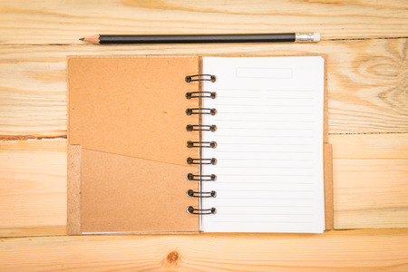 moles: Blank open notebook with pencil on wood table