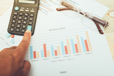correlate: calculator with  business charts
