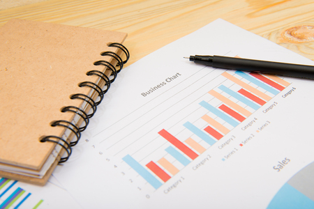 correlate: charts of growth on wood background , workplace businessman