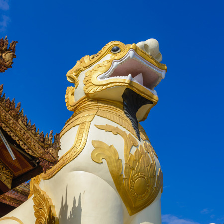 Myanmar arts and lion statues.