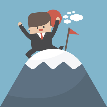 Businessman reached the top of the mountain and enjoying his victory.