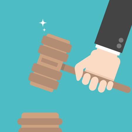 Hand holding judges gavel