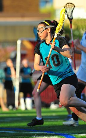 Girls lacrosse player on the move