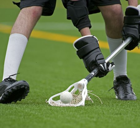 Lacrosse player scooping up the ball 2 Stock Photo - 5129474