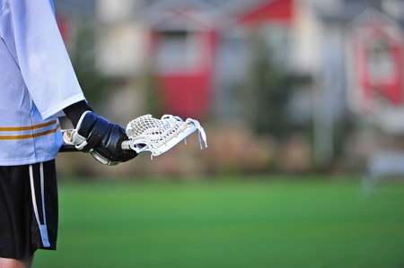 Boys Lacrosse stick as a player waits for action photo