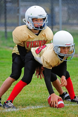 Sept 17, 2011 American Football (Youth 5-6th Grade) Oregons Forest Grove HS Vikings Youth  V Hillsboro Century HS Jaguars.   Forest Grove Vikings scrimmage line as the center waits for the quarterbacks command to put the ball into play.  Score not kept.