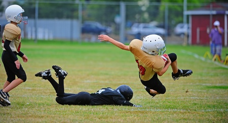 Sept 17, 2011 American Football (Youth 5-6th Grade) Oregons Forest Grove HS Vikings Youth  V Hillsboro Century HS Jaguars.   Century Jag falls to the ground just short of the elusive Viking, but the Viking is unable to recover.  Score not kept. Editorial