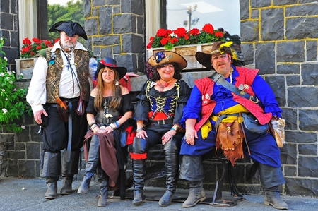 invaded: September 03, 2011 Portland Oregon Pirates Festival invaded historic St Hellens Oregon this year on September 03-04.  Here a motley crew of pirates sit on a bench out in front of the Columbia county court house.