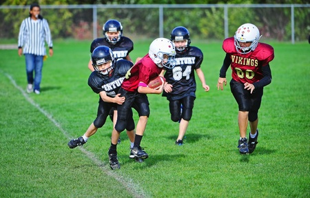 October 22, 2011 American Football (Youth 5-6th Grade) Hillsboro Oregon Century HS Youth V Forest Grove High School.  Century Jaguar grabs hold of the Viking from Forest Grove and tries to pull him down out of bounds.  Score not kept. Editorial