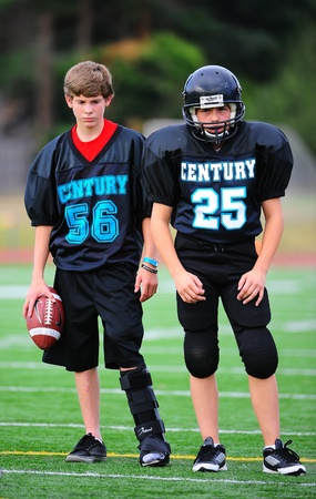 titans: September 21, 2011 American Football (Youth 7-8th Gr) Hillsboro Or Century HS youth V Forest Grove Jr High Titans. Century Jags #56 & #25 watch practice.  #56 sporting a boot on his lt foot from a prior injury.  Final score 34-26  Forest Grove Editorial