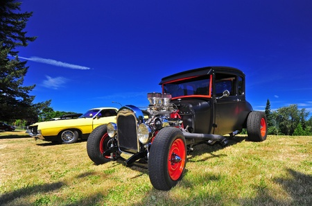 July 09, 2011 The 2011 Gorge Days in North Bonneville, WA car show.  Cars are lining up on the grass under the clear blue skies in the Columbia River Gorge. Stock Photo - 11414374
