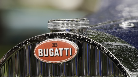 July 17, 2011 at the 2011 Forest Grove Concours dElegance.  The Bugatti front hood ornament and radiator cap still stand out and display the elegance of the show even as the rain fell on the cars through out the day. Editorial