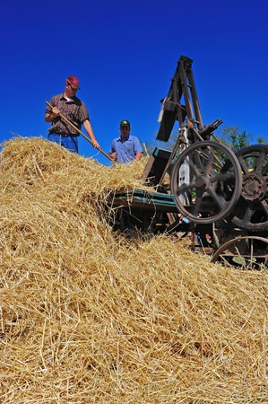 July 30, 2011 Great Oregon Steam Up held in Brooks Oregon at the Antique Powerland museum.  This photo captures the blue of the wheel as volunters demonstrate the fully operational 1918 Hay Bailer for the visitors.