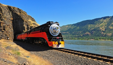 July 02, 2011 Southern Pacific Lines Daylight Steam engine #4449 comes out of a tunnel with a natural portal in the Columbia River Gorge durring it