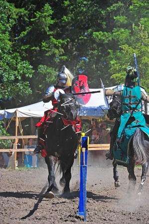 fayre: Saturday July 23, 2011 Canterbury Renaissance Fayre held this year just off Mount Angel Highway in Silverton Oregon.  Here the the Red knight charges towards the Green knight during a Jousting competition.  The Red Knight appears to be about to hit the Gr