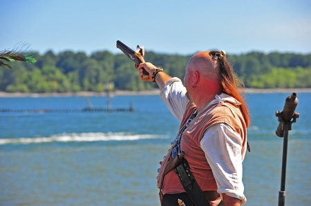 invaded: September 03, 2011 Portland Oregon Pirates Festival invaded historic St Hellens Oregon this year on September 03-04.  Here you can see the flame from the cap as a pirate fires his pistol during the firearms demonstration.