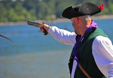 invaded: September 03, 2011 Portland Oregon Pirates Festival invaded historic St Hellens Oregon this year on September 03-04.  Here a pirate prepares to fire his pistol during the firearms demonstration.