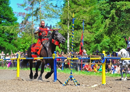 fayre: Saturday July 23, 2011 Canterbury Renaissance Fayre held this year just off Mount Angel Highway in Silverton Oregon.  Here the red Knight attempts to place his lance in the brass ring during the second round of competition.