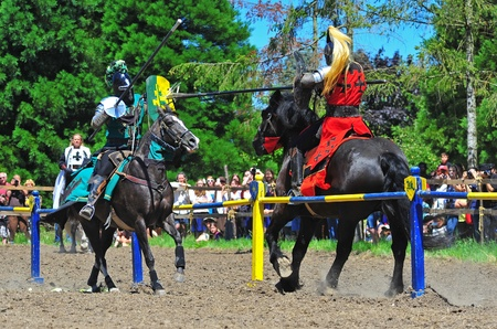 fayre: Saturday July 23, 2011 Canterbury Renaissance Fayre held this year just off Mount Angel Highway in Silverton Oregon.  Here the red Knight breaks his lance on the green Knights shield during the morning jousting competition.