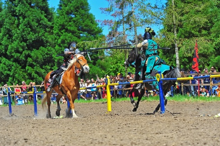 fayre: Saturday July 23, 2011 Canterbury Renaissance Fayre held this year just off Mount Angel Highway in Silverton Oregon.  Here the black and the green knights approach in the first round of jousting competition.