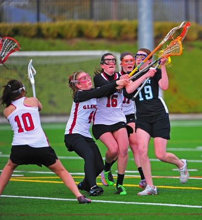 April 25, 2011 OGLA (Oregon Girls Lacrosse) Hillsboro Oregon Century High School Jaguars Varsity V Glencoe High School Crimson Tide. Century Jag #19 Lexis Pearson faces a block from the Crimson Tide as she tries to take a shot.  Final score 14-8 Century.