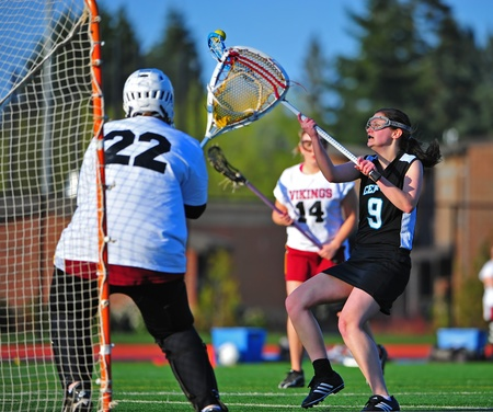 grasp: April 22, 2011 OGLA (OR Girls Lacrosse) Hillsboro OR Century HS Jaguars Varsity V Forest Grove HS Vikings. Century Jag Sophmore #9 Clarrissa Boggs tries to keep the ball from falling into the Vikings goalie grasp.  Final score 13-1 Century. Editorial