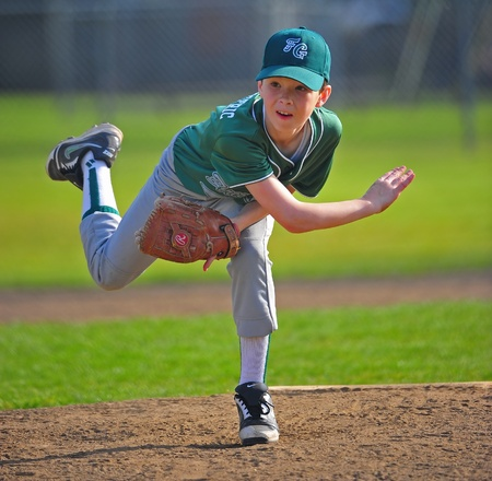 April 23, 2011 Junior Baseball of Oregon Little leauge.  Forest Grove Green V Forest Grove Blue.  Green pitcher #6 Scott Couch follows through one of his pitches in the game.  Blue team forfeited in 5th of 6 innings.