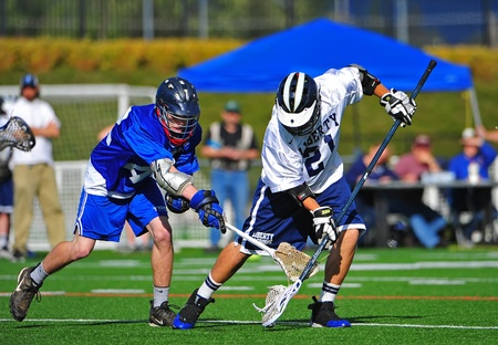 playoffs: May 18, 2011 OHSLA Game 2 of Oregon State 1st round of playoffs.  Hillsboro Liberty HS Falcons Varsity V Newberg OR Tigers. Falcon #21 sweeps the ball away from Tigers #42 stick.  Final score 11-4 Liberty, moving Liberty onto round 2 of the state playoffs