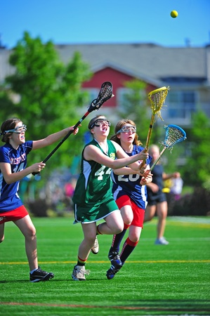June 04, 2011 OGLA (OR Girls Lacrosse) Hillsboro OR 53rd st tournament for 5-6th grade girls. 8:00am Westview V West Linn, West Linn player #44 moves ahead of her West View competition (#20 & # 19) to catch the ball after a dram. Final score 9-3 West Linn