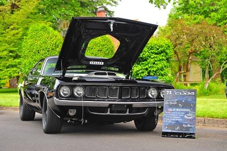 restored: June 11, 2011 21st Annual Crusin Sherwood Oregon car show.  A restored Black 1971 Plymouth Cuda with a 528 Hemi. Editorial