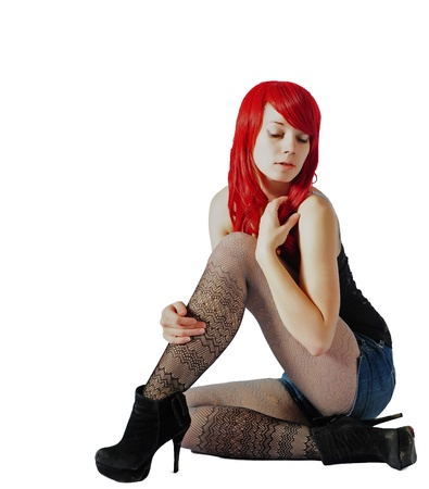A Beautiful woman wearing a red wig sitting photo