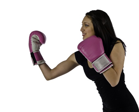 short gloves: A beautiful young woman in a little black dress and hi heels throws a right under cut as she is ready to block with her left