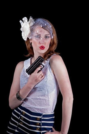 women with guns: Beautiful young woman with a handgun in vintage clothing  Stock Photo