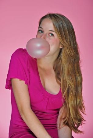 Pretty girl blowing bubble gun photo
