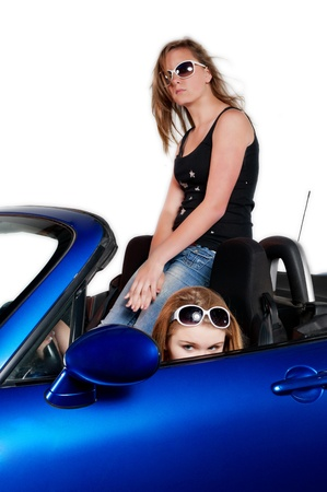 top down car: Two teenage girls dreaming of driving