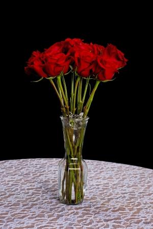 dozen: A dozen red roses in a vase