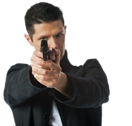 Man aiming handgun right at the camera