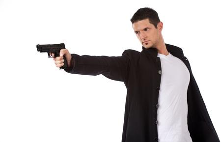hombre disparando: Hombre de tiro con arma corta con una mano Foto de archivo